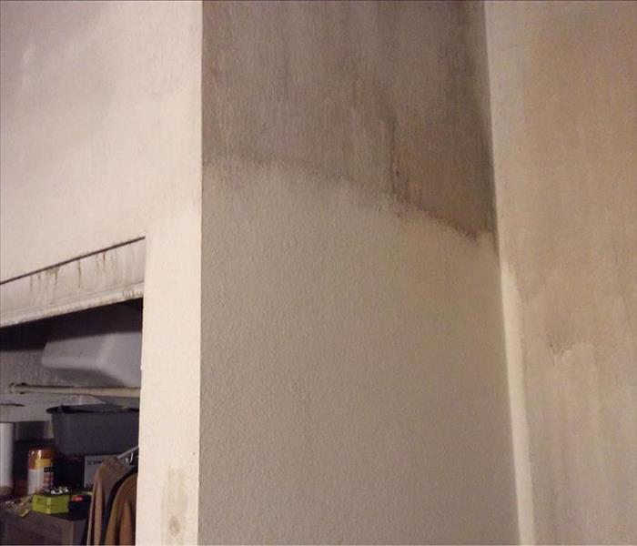 wall with smoke and soot partly removed