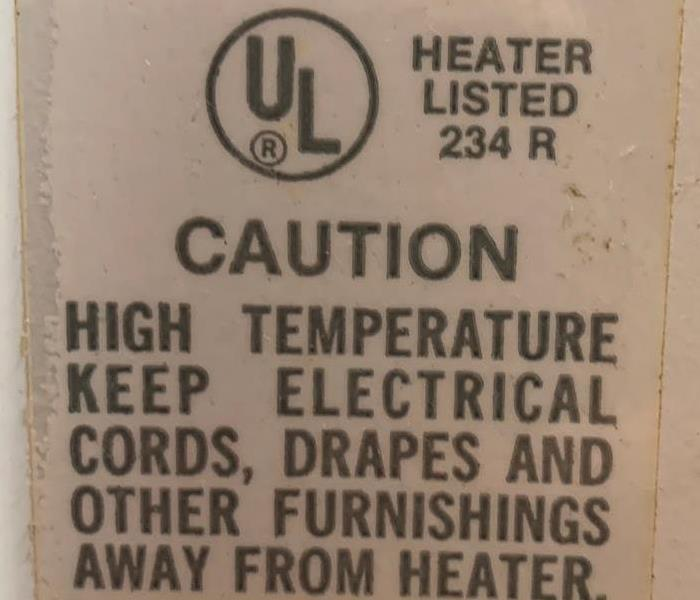 sticker on electric heater with UL approval and warnings